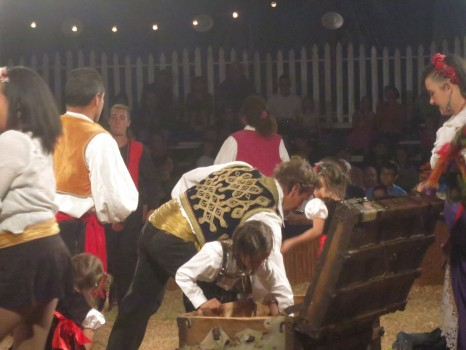 The performers pull props from the old family trunk.